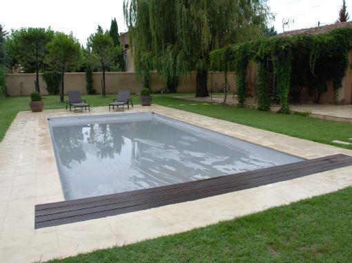 couverture de piscine aquaguard 4 saisons la solution. Black Bedroom Furniture Sets. Home Design Ideas